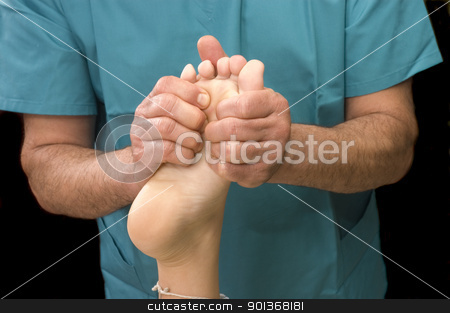 Woman having foot massage stock photo, Woman having foot massage by Jeffrey Banke