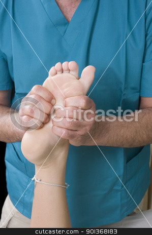 Woman having Massge stock photo, Woman getting Massage from a masseur by Jeffrey Banke