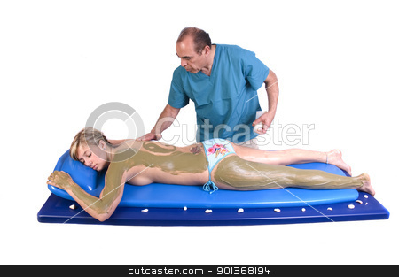Woman having Massge and seaweed body treatment stock photo, Woman getting Massage and seaweed treatment by Jeffrey Banke