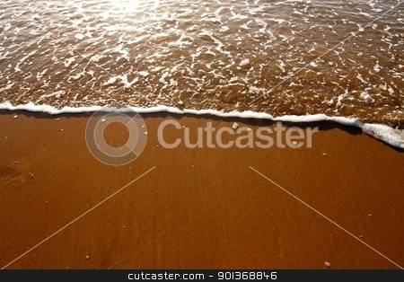 Sun and surf on a sandy beach stock photo, Sun and surf on a peaceful sandy beach by steve ball