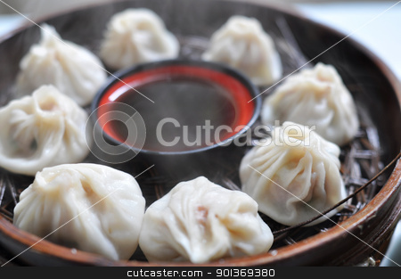 Steamed dumplings stock photo, A plate of steamed dumplings in Xian, China by John Young