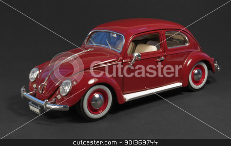 red model car in dark back stock photo, studio photography of a red VW Beetle model car in dark background by prill