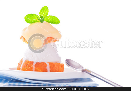 Profiterole in a small plate with ice cream vanilla sauce and mi stock photo, Profiterole in a small plate with ice cream vanilla sauce and mint leaf on a white backgound by p.studio66