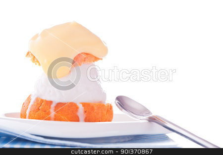 Profiterole in a small plate with ice cream vanilla sauce on a w stock photo, Profiterole in a small plate with ice cream vanilla sauce on a white backgound by p.studio66