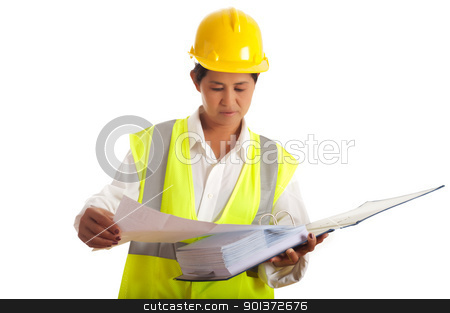 Engineer at work stock photo, A woman working as an engineer in a yellow safety vest and yellow helmet by p.studio66