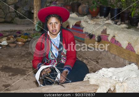 Peruvian woman weaving stock photo, Cusco , Peru - May 26 2011 : Quechua Indian woman weaving  by Kobby Dagan