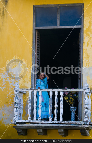 Cartagena de Indias stock photo, Catagena de Indias , Colombia - December 21 2010 : Girl in a balcony in  an old house  by Kobby Dagan