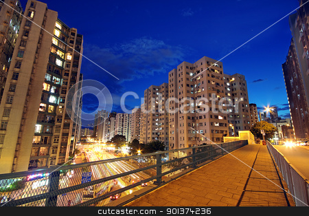 modern urban city at night with freeway traffic stock photo, modern urban city at night with freeway traffic by Keng po Leung