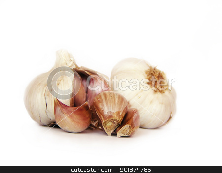 Clove of garlic stock photo, Clove of garlic, with garlics on the background by orson