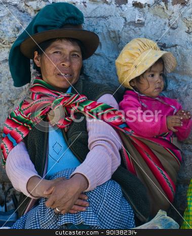 Peruvian mother stock photo, Cusco , Peru - May 28 2011 : Peruvian woman with here child in a market in Cusco Peru by Kobby Dagan