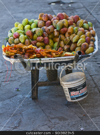 Cactus fruits stock photo, opuntia cactus fruits on a wheelbarrow in a local street market in Cusco Peru by Kobby Dagan