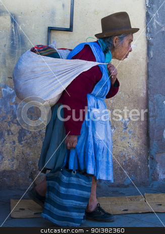 Peruvian woman stock photo, Cusco , Peru - May 31 :  Peruvian woman walk in the narrow alleys of  Cusco Peru  by Kobby Dagan