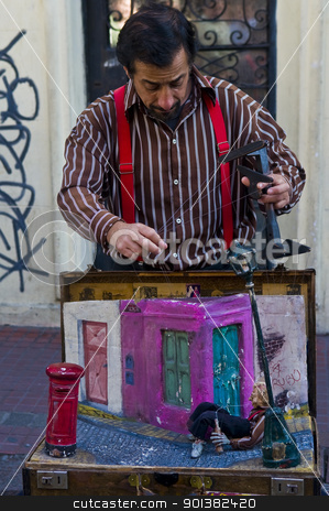 Puppeteer stock photo, BUENOS AIRES  , ARGENTINA  - APR 24 2011 : Puppeteer in a street puppet show in Buenos aires Argentina   by Kobby Dagan