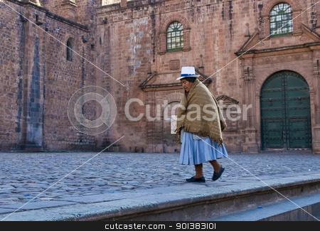 Peruvian woman stock photo, Cusco , Peru - May 29 :  Peruvian woman walk near the Cusco cathadral by Kobby Dagan