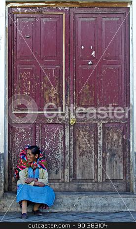 Peruvian woman stock photo, Cusco , Peru - May 30 2011 :  Peruvian woman seat near a door in a street in Cusco Peru  by Kobby Dagan