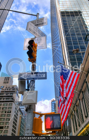 Building in New York stock photo, Skyscrapers with amerian flags in downtowm Manhattan by Kobby Dagan
