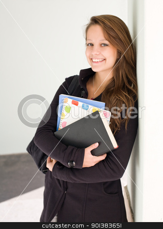 Cute young student. stock photo, Half length portrait of a cute young smiling student with exercise books. by exvivo
