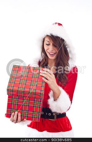 Mrs. Santa opening a gift box  stock photo, Mrs. Santa opening a gift box, isolated on white by Grafvision