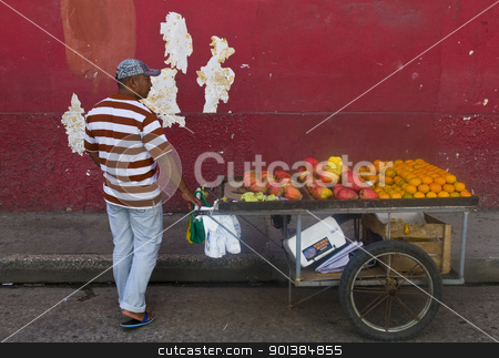 Colombian fruit seller stock photo, CARTAGENA DE INDIAS , COLOMBIA - DEC 24:Unidentified colombian man sell fruits in the street in Cartagena de Indias on December 24 2010 by Kobby Dagan