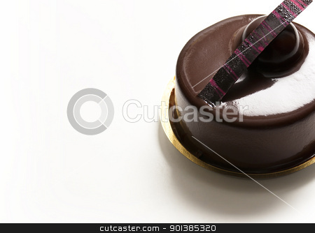 Chocolate Pastry stock photo, Close-up photograph of a chocolate pastry set on a white background by mpessaris