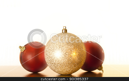 Three Christmas Baubles stock photo, Close-up photograph of three christmas balls on a white background with copyspace  by mpessaris