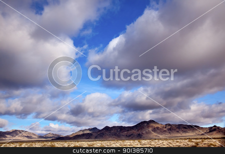 Desert Cloudscape California stock photo, Desert Cloudscape Blue Skies Clouds Towering Over Landscape California Near Death Valley by William Perry