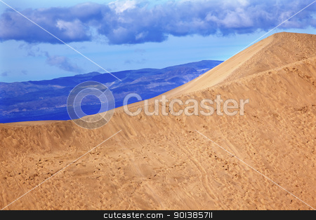 Large Sand Dune Mesquite Flat Dunes Grapevine Mountains Death Va stock photo, Large Sand Dune Mesquite Flat Dunes Grapevine Mountains Death Valley National Park California Ridge Line by William Perry