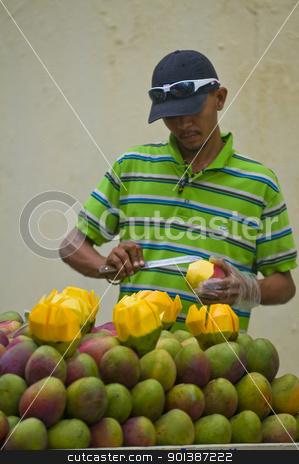 Colombian fruit seller stock photo, CARTAGENA DE INDIAS , COLOMBIA - DEC 21:Unidentified colombian man sell fruits in the street of Cartagena de Indias on December 21 2010 by Kobby Dagan