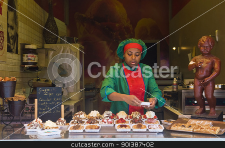 Waffal seller  stock photo, BRUSSELS - JULY 2 : Unidentified waffal seller in a typical waffal stand in Brussels Belgium on July 2 2011. by Kobby Dagan