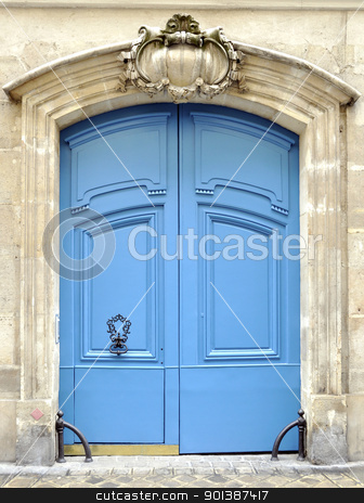 A blue door in Paris stock photo, A blue door in Paris, France by Dutourdumonde