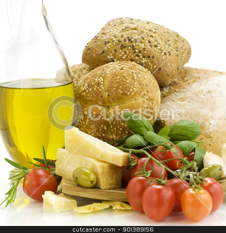 Fresh bread, herbs and vegetables stock photo, Fresh ingredients for an Italian dinner and appetizers over white by klenova
