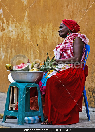 Palenquera fruit seller stock photo, CARTAGENA DE INDIAS , COLOMBIA - DEC 21:Unidentified Palenquera woman sell fruts in Cartagena de Indias on December 21 2010,Palenqueras are  a unique African descendat ethnic group found in the north region of South America by Kobby Dagan