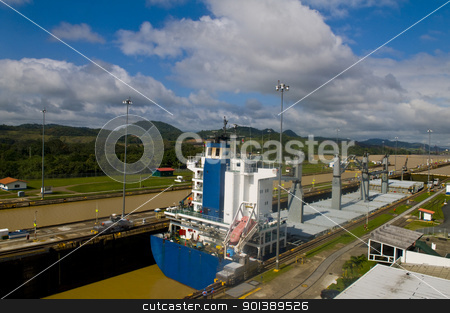 Panama canal stock photo, PANAMA CANAL , PANAMA - DEC 25 2010 : Huge ship crossing the Panama canal by Kobby Dagan