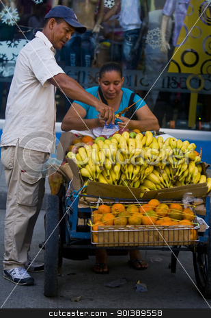 Colombian fruit seller stock photo, CARTAGENA DE INDIAS , COLOMBIA - DEC 18 :Unidentified colombian woman sell fruits in the street in Cartagena de Indias on December 18 2010 by Kobby Dagan