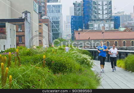 High line park in New York stock photo, NEW YORK -  JUNE 23 2011 : Unidentified people jog through the High line park in Manhattan New York city on June 23 2011 , The elevated High line park built on a 1930's freight rail line by Kobby Dagan