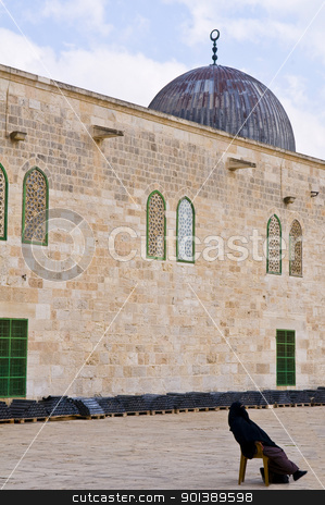 El Aqsa mosque stock photo, JERUSALEM - NOV 03 : Palestinian woman seat near