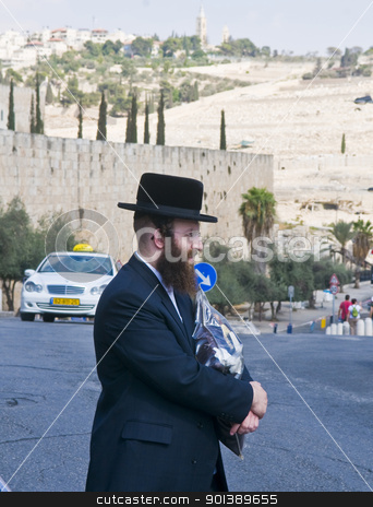 Jew in old Jerusalem stock photo, JERUSALEM - OCTOBER 06 2011 : An ultra- Orthodox Jewish man stand near the walls of old  Jerusalem , Israel by Kobby Dagan