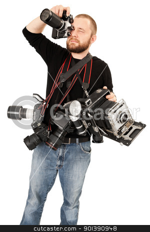 Photography enthusiast stock photo, Photo of a man in his late twenties, standing and holding many cameras, film, digital, medium format and large format. by © Ron Sumners