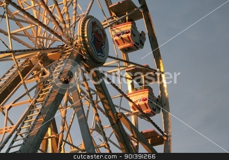 Ferris wheel stock photo, Ferris wheel in the early morning sunlight by Denis Brien