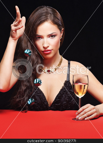 young woman holding dices on red table stock photo, pretty young woman holding dices on red table by iMarin