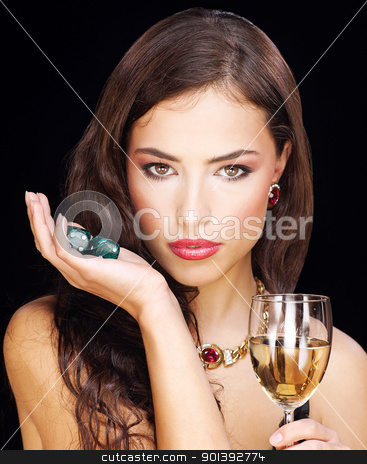 young woman holding dices on black background stock photo, pretty young woman holding dices on black background by iMarin