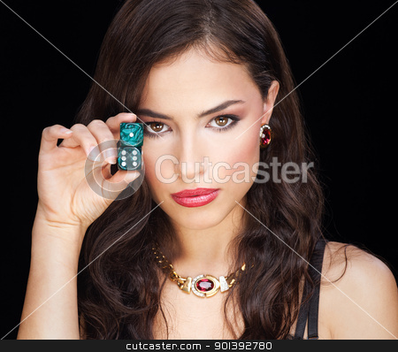 woman holding dices on black background stock photo, woman holding dices on black background by iMarin