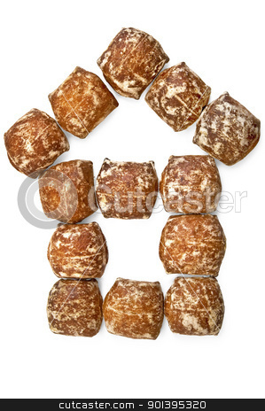 Gingerbread house stock photo, Gingerbread with white icing put in the form of the house is isolated on a white background by rezkrr