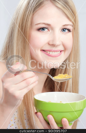 Smiled woman holding spoon and plate stock photo, Smiled woman holding spoon and plate, preparing to eat cornflex by iMarin