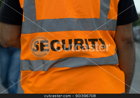 Security guard stock photo, Back of a security guard in orange uniform jacket by Harry Huber