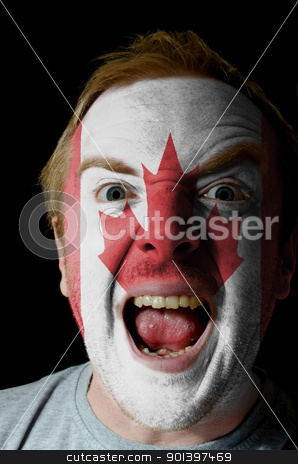 Face of crazy angry man painted in colors of Brazil flag stock photo, Low key portrait of an angry man whose face is painted in colors of brazilian flag by Vedran Vukoja