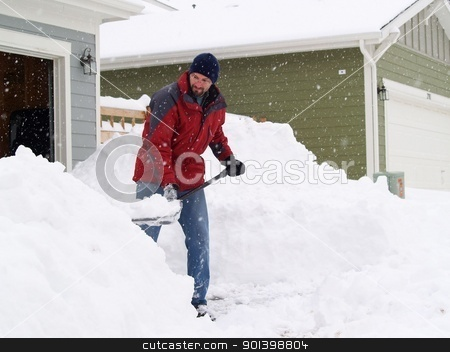snow shoveling stock photo, Man shoveling a lot of snow during a blizzard. by Cora Reed
