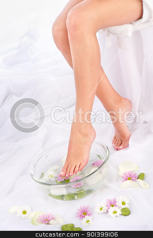 legs in aromatherapy bowl stock photo, Slim legs in aromatherapy bowl, composition sided by iMarin