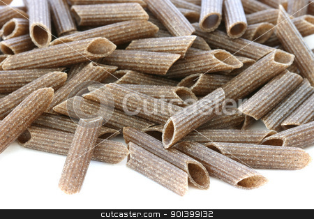 Raw wholegrain pasta stock photo, Raw wholegrain pasta scattered on white background by Daniel Oertelt