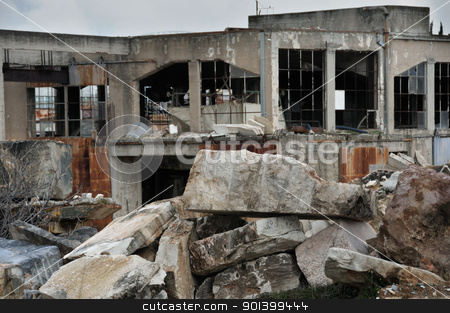 marble factory ruins stock photo, Abandoned marble processing factory and pile of granite slates. Industrial ruins. by sirylok